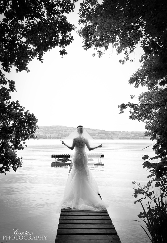 Award winning wedding photography - Bride on the pier at Two Mile Gate, Killaloe, Co Clare